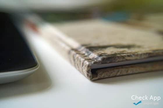 Myphotobook_app_Fotobuch_erstellen_minutenschnell_Vergleich_Buch_Tablet